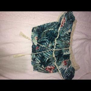 off the shoulder cropped floral patterned shirt.
